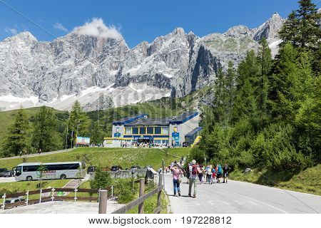 DACHSTEIN MOUNTAINS AUSTRIA - JULY 17 2017: People walking to the valley station of Austrian Dachstein glacier cable car