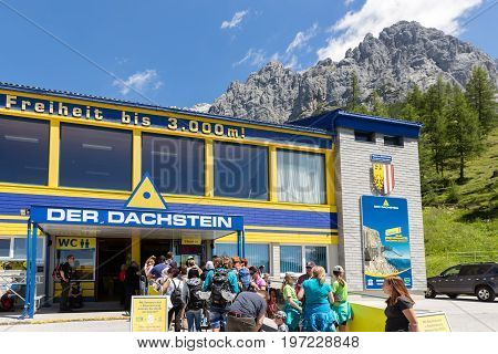 DACHSTEIN MOUNTAINS AUSTRIA - JULY 17 2017: People waiting at the valley station of the Dachstein glacier cable car in Austria