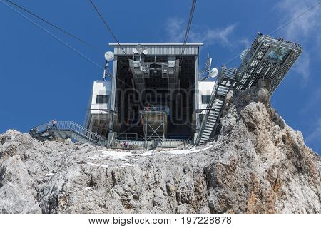 DACHSTEIN MOUNTAINS AUSTRIA - JULY 17 2017: View at Austrian Dachstein mountain station of cable car with waiting people