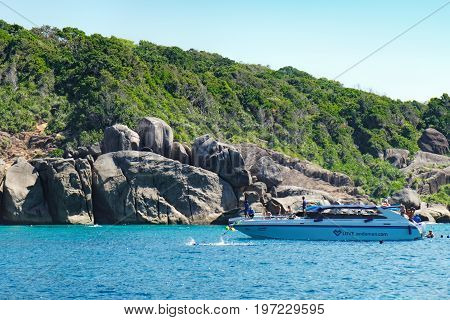 Phang Nga, Thailand - January 4, 2016: View from the tour boat to the Similan Island, Andaman Sea, Thailand. People snorkeling and diving in crystal blue water.