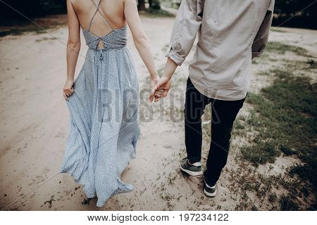 Stylish Hipster Couple Walking, Holding Hands. Man And Woman Embracing, In Love Relaxing In Summer P