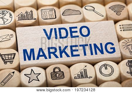 Full frame shot of video marketing text on wooden block surrounded by various computer icons