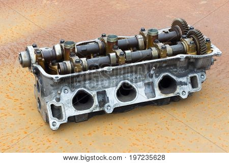 Old Cylinder Head And Bent Shaft On The Background Of Rusty Metal, Broken Engine