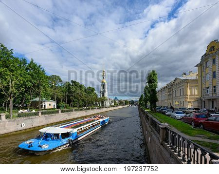 SAINT PETERSBURG/ RUSSIA - JULY 2, 2017. View of the embankment of the Krjukov canal and the belfry of St. Nicholas Cathedral. Saint Petersburg, Russia.