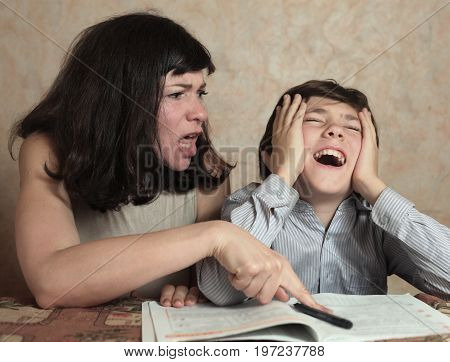 mom help son make difficul homework task scold him for being dumb