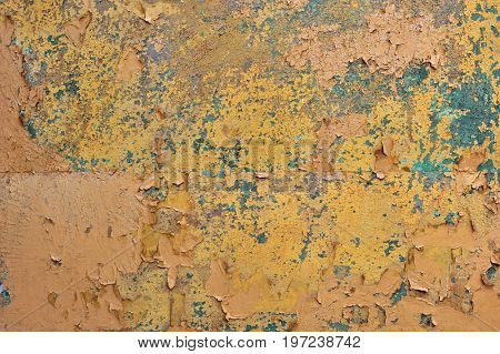 Orange brown old rusted corroded metal or steel sheet horizontal wall background as abstract dirty textured metallic vintage industrial closeup. A rough iron aged plate