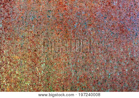 Colorful grunge rust stain texture rusty copper wall, a close up photo of colorful grunge rust stain on a rusty copper wall present a detail of a grunge rust stain texture on that rusty copper wall that consist of red, brown, green and blue color rust sta