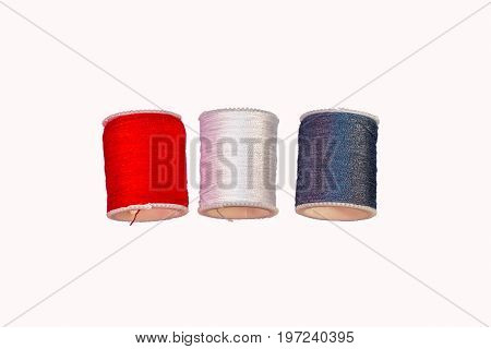 Many Color Cotton Reel Spools of Sewing Thread on White Background