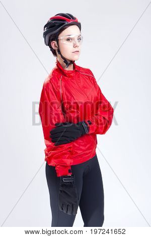Sport Concepts and Ideas. Portrait of Caucasian Female Cycling Athlete Posing Equipped in Professional Outfit in Studio.Vertical Image Orientation