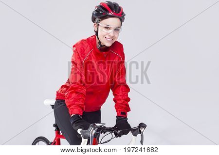 Cycling Concepts. Portrait of Caucasian Female Cyclist Equipped in Cycling Outfit and Posing With Road Bike In Studio.Horizontal Image Orientation