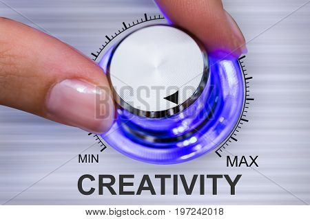 Close-up Of A Human Hand Maximizing Creativity Knob