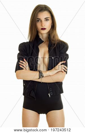 Sexual lady with big boobs without bra wears a black jacket and panties isolated on white background