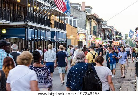 New Orleans, Usa - July 8, 2015: A Crowd Of People Walk In The Evening On Famous Bourbon Street In L