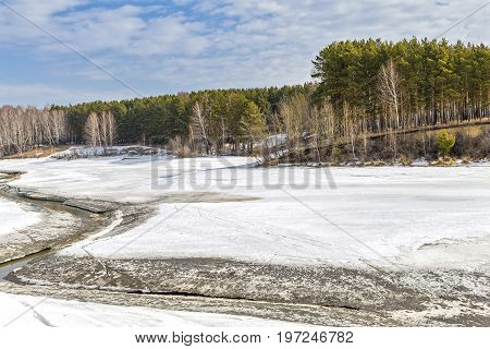 Spring landscape the beginning of the flood postmortem river spring nature melting ice River Separate a tributary of the river Ob Novosibirsk oblast Siberia Russia a suburb of Berdsk