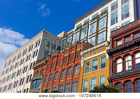 Modern and historic buildings at close up in Washington DC downtown. Examples of urban architecture of USA capital city.