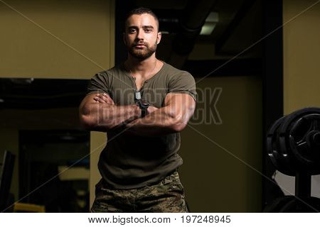 Portrait Of A Muscular Man In Green T-shirt