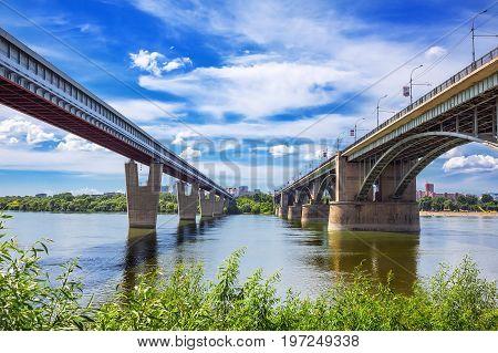 Novosibirsk Siberia Russia - July 17 2017: indoor bridge and October bridge ( former Municipal ) across the Ob river