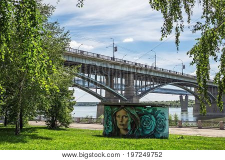 The river Ob Novosibirsk Siberia Russia - July 17 2017 October ( Utilities ) bridge and Mikhailovskaya the riverfront with landscaping