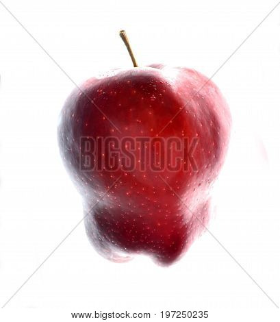 Isolate red apple, a side view close up photo image of red apple isolated on white background present a detail of texture and pattern on red apple surface