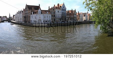 Bruges, Belgium - July 7, 2017: Panoramic View Of One Of The Several Canals In The Center Of Bruges,