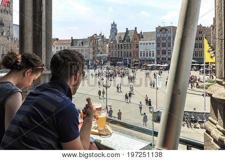 Bruges, Belgium - July 7, 2017: Tourists Drinking Beer And Eating Chocolate While Enjoying The A Pan