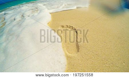 A footstep near the ocean water during a beautiful day in the tropics. Nassau, Bahamas.