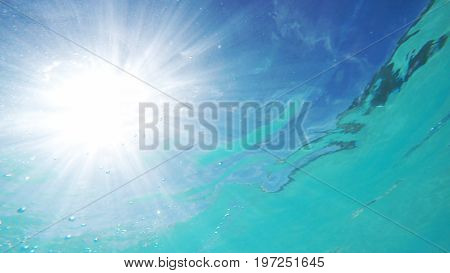 Underwater view of the water surface and the sun. Nassau, Bahamas.