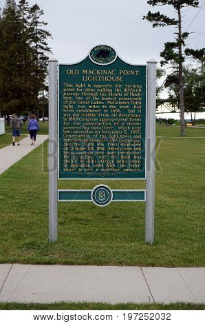 MACKINAW CITY, MICHIGAN / UNITED STATES - JUNE 18, 2017: A sign describes the historical significance of the Old Mackinac Point Lighthouse, which is a Michigan Historical Commission Registered State Site.