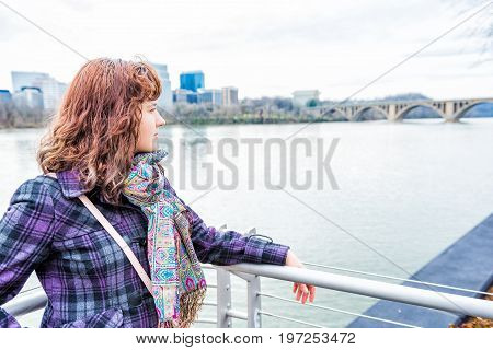 Profile Side Portrait Of Young Woman Looking Over Potomac River Key Bridge And Arlington Skyline In