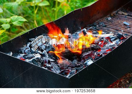 Bright flame and hot coal in the brazier for toasting