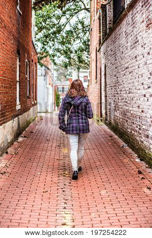Back On Young Woman Walking In Alley Way With Brick Cobblestone In Georgetown Neighborhood Of Washin