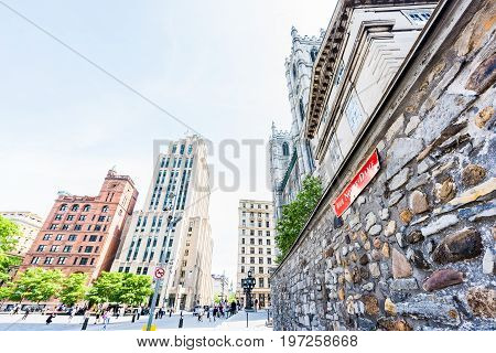 Montreal, Canada - May 28, 2017: Old Town Area With Notre Dame Basilica Street Sign In Red During Da