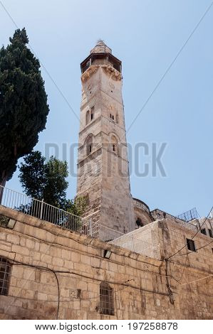 Minaret of the Mosque Omar next to the courtyard of the Church of the Holy Sepulchre in the old city of Jerusalem Israel.