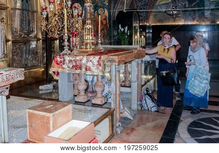 Jerusalem Israel July 14 2017 : Fragment of the interior of the Church of the Holy Sepulchre in Jerusalem Israel. Believers stand in line to touch Golgotha.