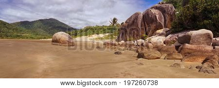 A sandy beach with rocks in Finch Bay Cooktown Australia