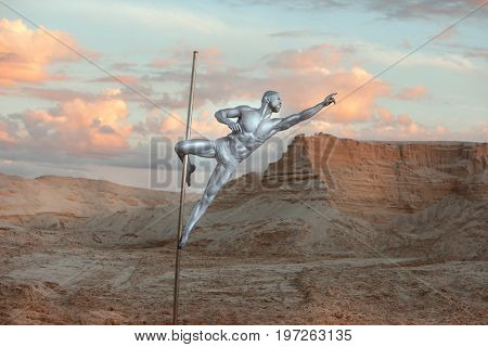 Man is engaged in Pole Dance on a pole in the desert sands.