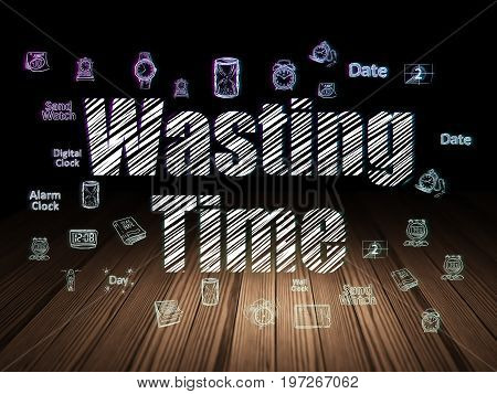 Time concept: Glowing text Wasting Time,  Hand Drawing Time Icons in grunge dark room with Wooden Floor, black background