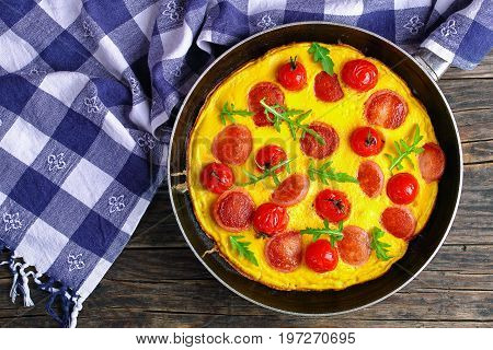Tasty Omelette With Sausages On Skillet