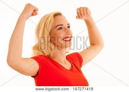 Attrctive Young Blonde Woman Gesture Success With Arms Up Isolated Over White Background