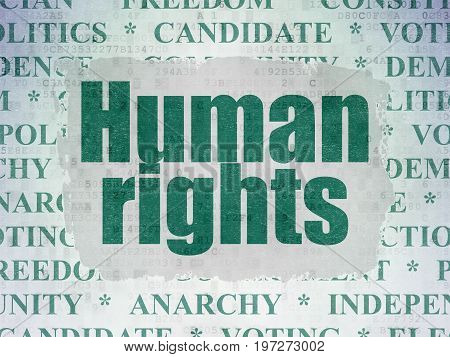 Political concept: Painted green text Human Rights on Digital Data Paper background with   Tag Cloud