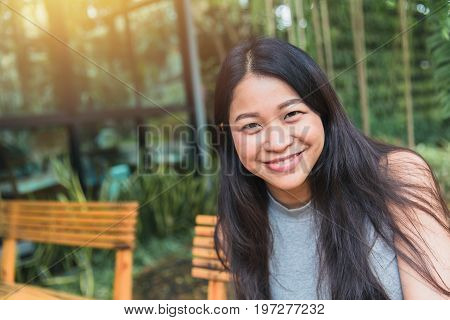 Portait Asian Women Black Long Hair Adult Happy Smile Enjoy In The Garden Cafe With Space For Text.
