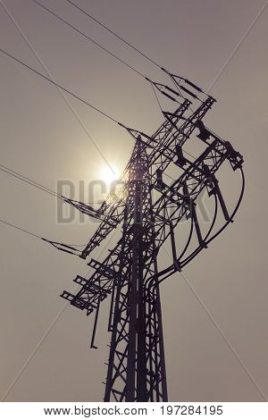 High-voltage power line tower carry green electricity sun energy. Ironman business is transmission of renewable sustainable power to prevent climate change and heal the world. Important modernization of grid.