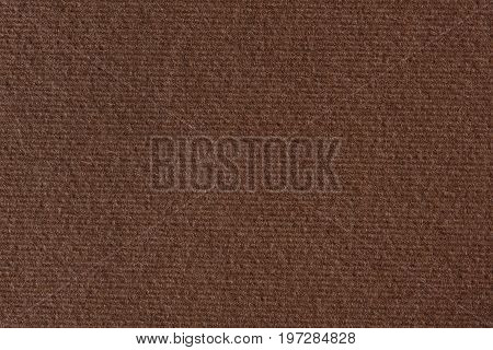 Dark brown paper background texture. High resolution photo.