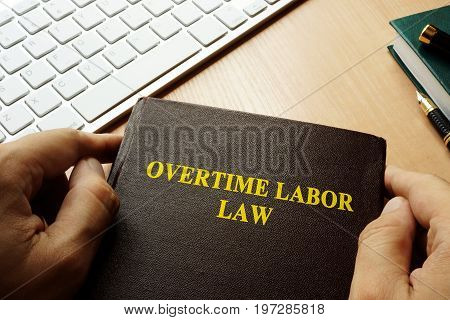 A Book with title overtime labor law.