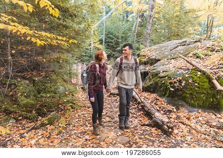 Couple Hiking In The Woods In Canada