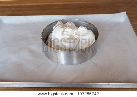 Form For Baking Cake With Dough On Baking Tray With Parchment Paper. Dough For Homemade Cake In Meta