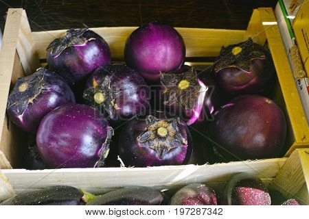 Violet eggplant fresh healthy vegetables in wooden box