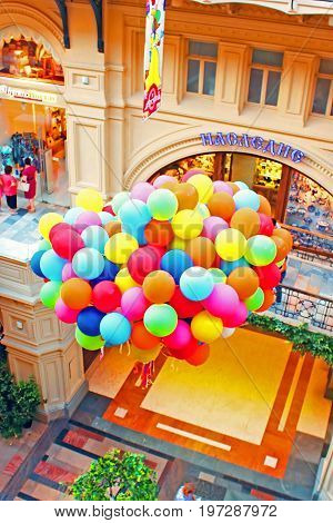 MOSCOW, RUSSIA - JUNE 05, 2013: Balloons inside the GUM (main department store). GUM is located on the Red Square and is one of the oldest supermarkets in Moscow, Russia