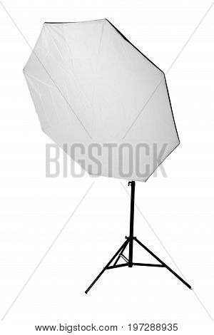 A professional metal octobox, isolated on a white background. The black octobox in a form of umbrella. Equipment for photographers. The huge and tall octobox.