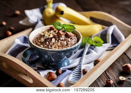 Oatmeal Porridge With Banana, Hazelnut, Chocolate And Honey
